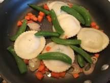 rav in pan with peas