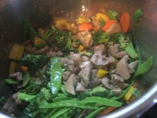 chicken with broc in pan