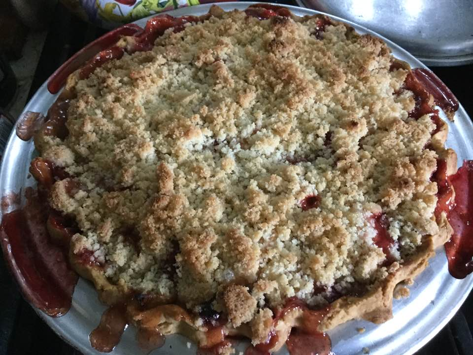 apple cranberry crumb pie out of oven